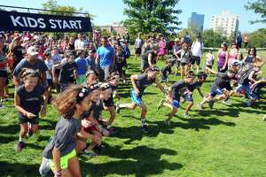 Kids get a running start for the Spartan Kids Race at Mill River Park in downtown Stamford, Conn. on Sunday, Sept. 24, 2017.