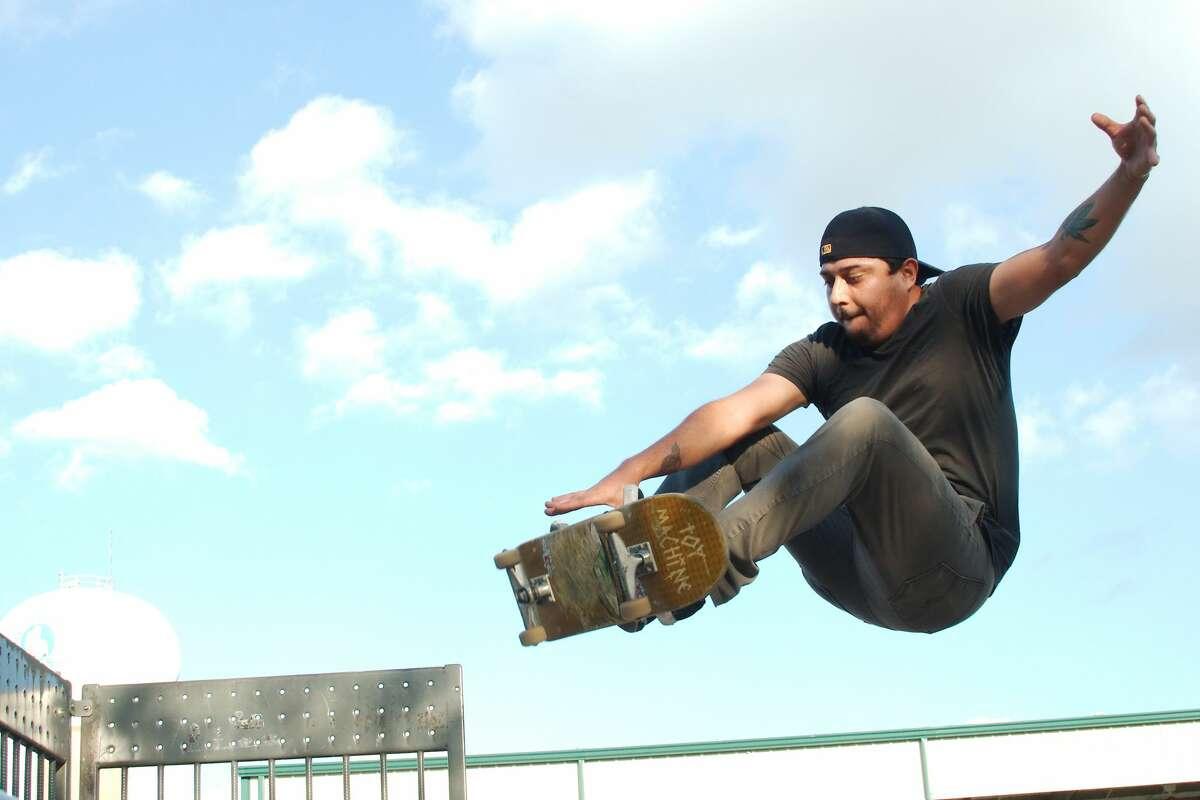 Andy Delgado performs a skateboard trick at the skate park in Pasadena Memorial Park.