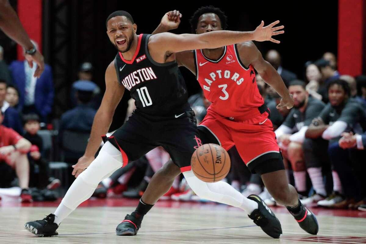 Houston Rockets' Eric Gordon, front, goes after a loose ball under defense by Toronto Raptors' OG Anunoby during the first half of an NBA preseason basketball game Thursday, Oct. 10, 2019, in Saitama, near Tokyo. (AP Photo/Jae C. Hong)