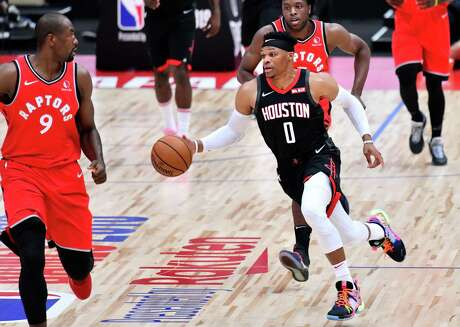 Houston Rockets guard Russell Westbrook (C) dribbles the ball during the National Basketball Association (NBA) Japan Games 2019 pre-season basketball match between the Houston Rockets and Toronto Raptors in Saitama, a northern suburb of Tokyo on October 10, 2019. (Photo by TOSHIFUMI KITAMURA / AFP)