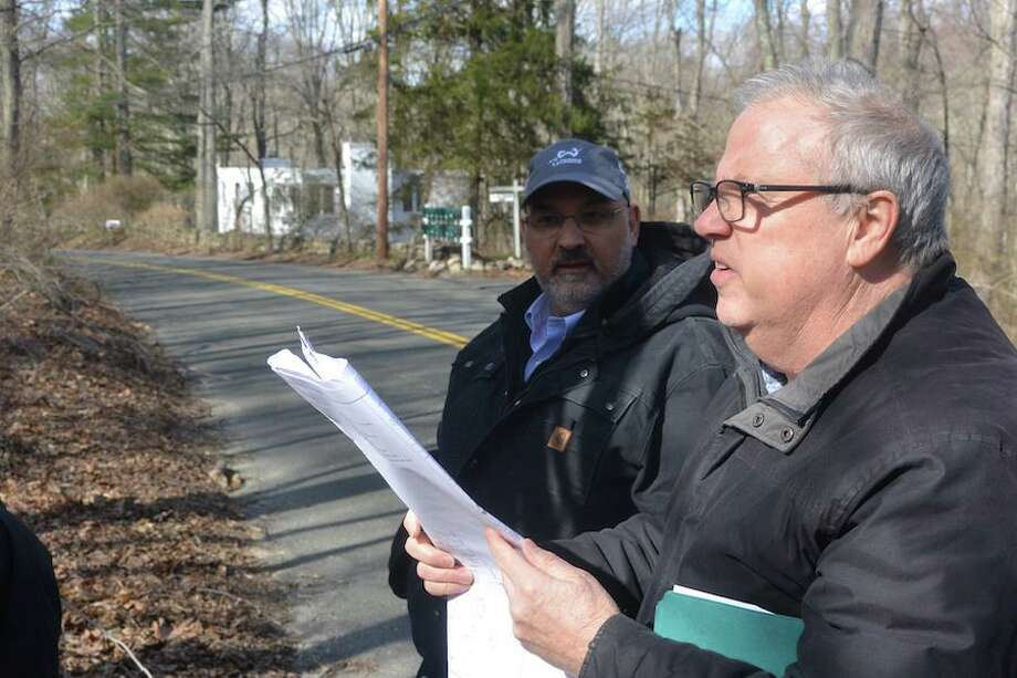 Wilton Town Planner Bob Nerney, right, looks over plans with Planning and Zoning Commissioner Richard Tomasetti at a site walk in Cannondale. Photo: Hearst Connecticut Media / Wilton Bulletin