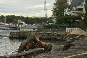 The aftermath of a seawall collapse on Steamboat Road in Greenwich.