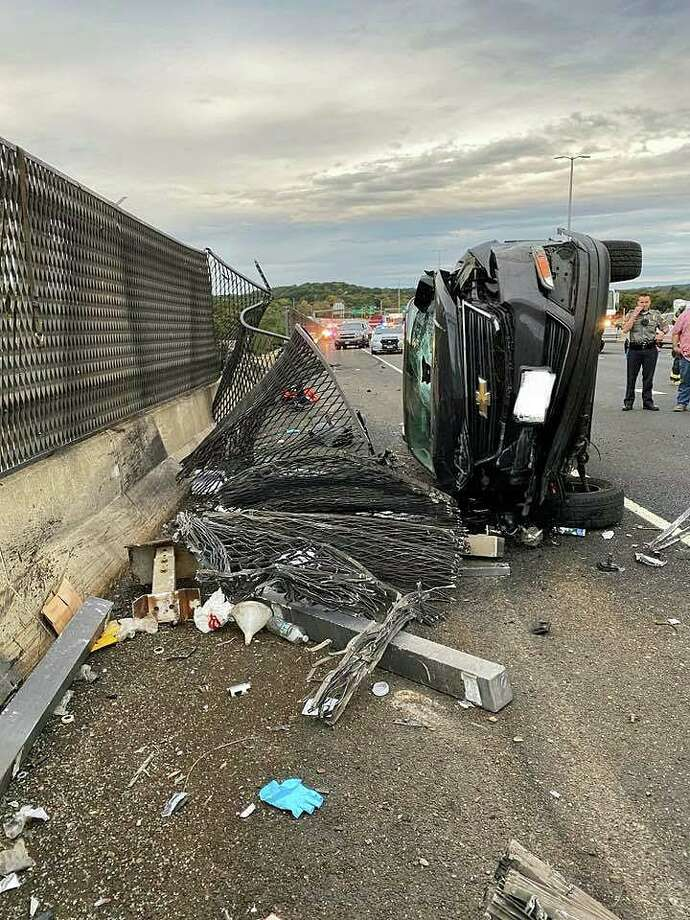 A vehicle that overturned on I-95, sheared off a section of fencing on the Baldwin Bridge over the Connecticut River in Old Saybrook on Thursday, Oct. 10, 2019 After rolling over, the vehicle traveled several feet ripping the metal fence. A container on top of the vehicle was pulled off and fell into the river. Photo: Old Saybrook Fire Department