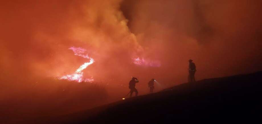 Firefighters work to contain a wildfire burning off Merrill Dr. in Moraga, Calif., on Thursday, Oct. 10, 2019. Photo: Moraga-Orinda Fire District