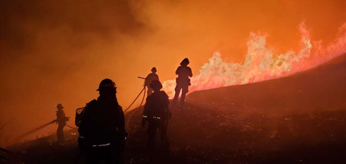 Firefighters work to contain a wildfire burning off Merrill Dr. in Moraga on Thursday, Oct. 10, 2019.