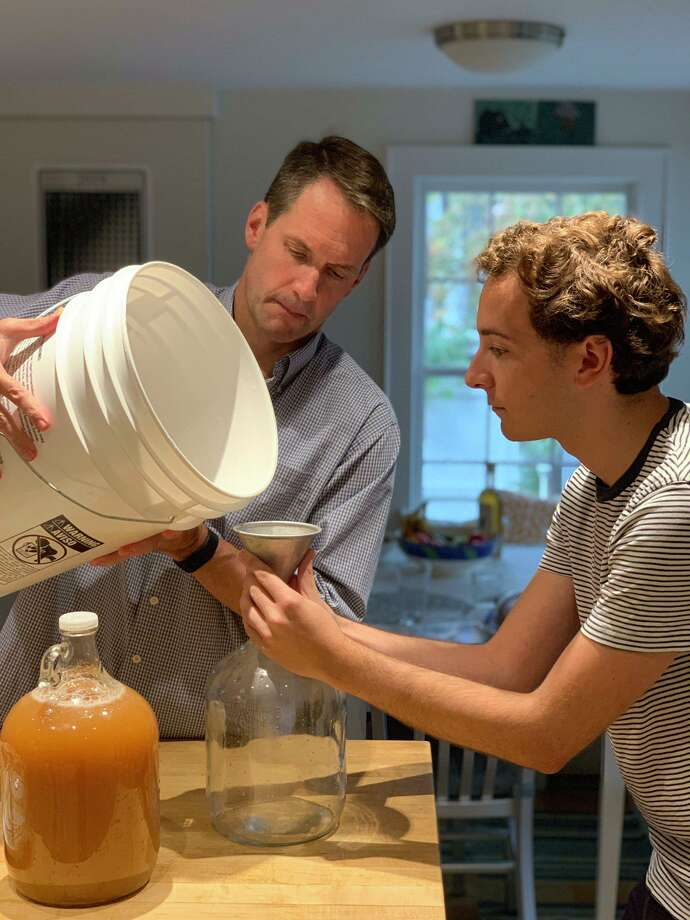 U.S. Rep. Jim Himes and state Sen. Will Haskell make hard cider together. Photo: Will Haskell / Submitted
