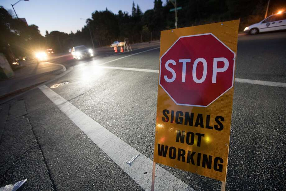 Traffic lights were out in the Montclair neighborhood of Oakland, Calif. on Oct. 10, 2019. PG&E cut power to customers in Northern California and the East Bay to prevent wildfires during dry, windy weather throughout the region. Photo: Douglas Zimmerman/SFGate