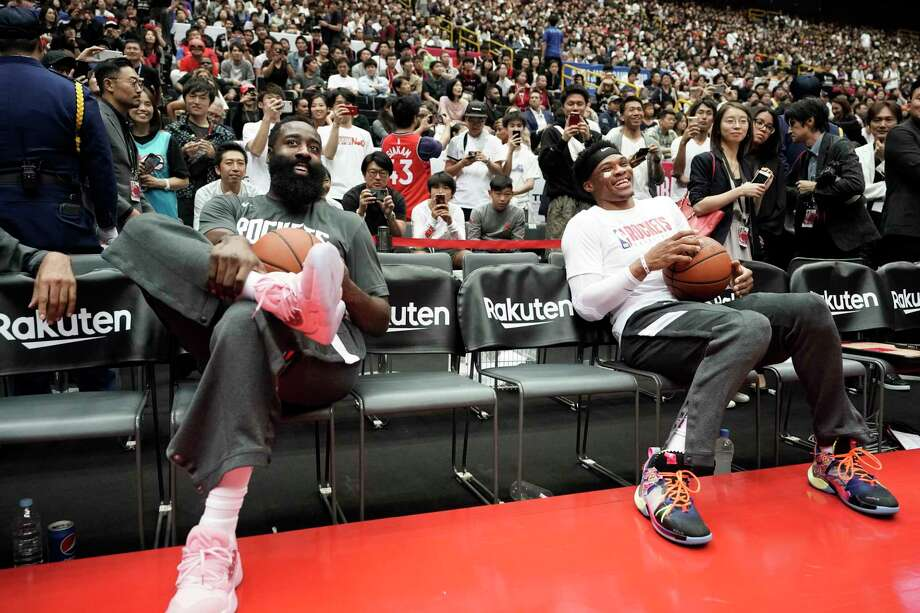Houston Rockets' James Harden, left, and Russell Westbrook share a light moment during warmups for the team's NBA preseason basketball game against the Toronto Raptors Thursday, Oct. 10, 2019, in Saitama, near Tokyo. (AP Photo/Jae C. Hong) Photo: Jae C. Hong, Associated Press / Copyright 2019 The Associated Press. All rights reserved.