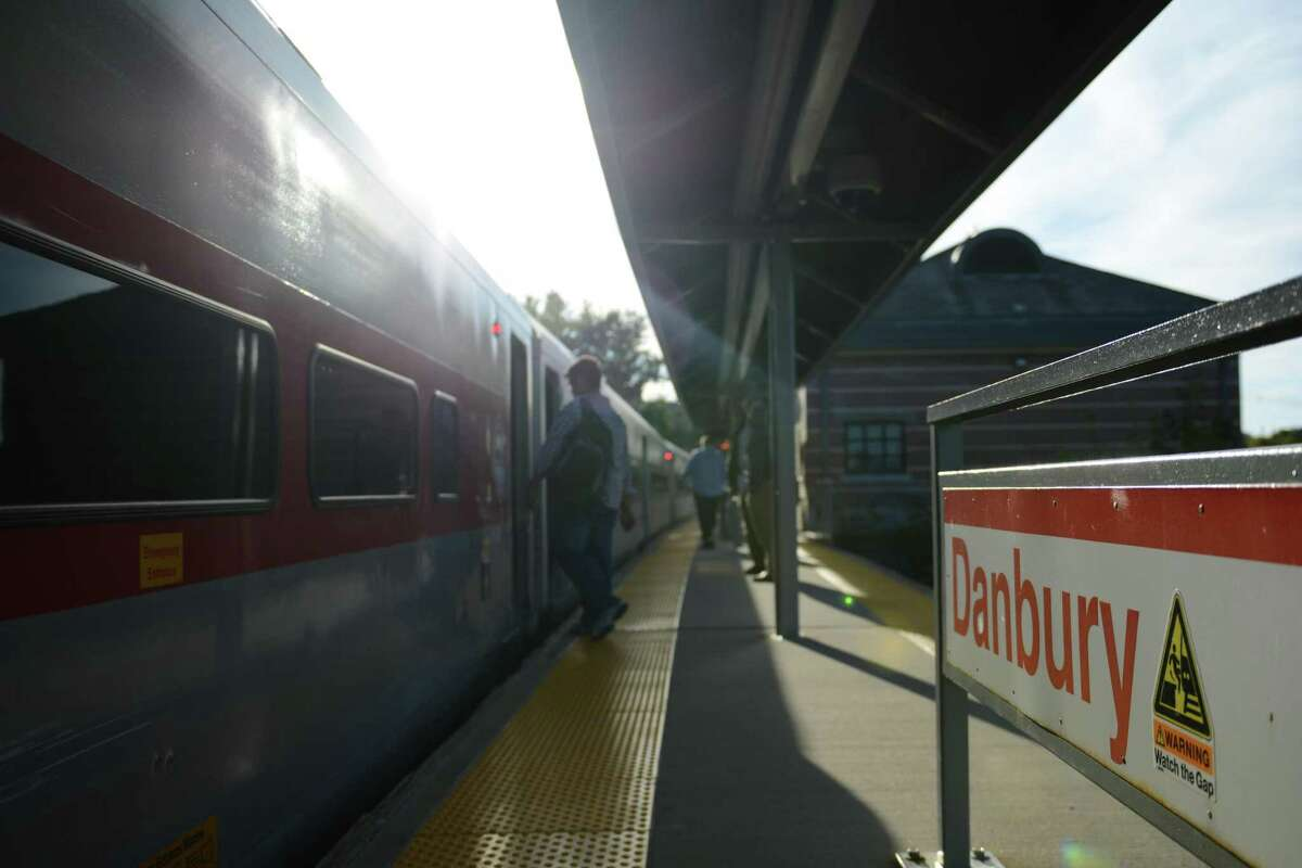 Commuters board the Metro-North train bound for South Norwalk at the train station in Danbury, Conn.