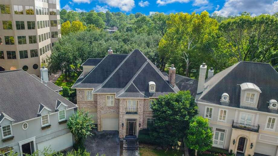 This 5-bedroom Memorial home, 326 Park Laureate, is under foreclosure at $1.399 million. Photo: Houston Association Of Realtors