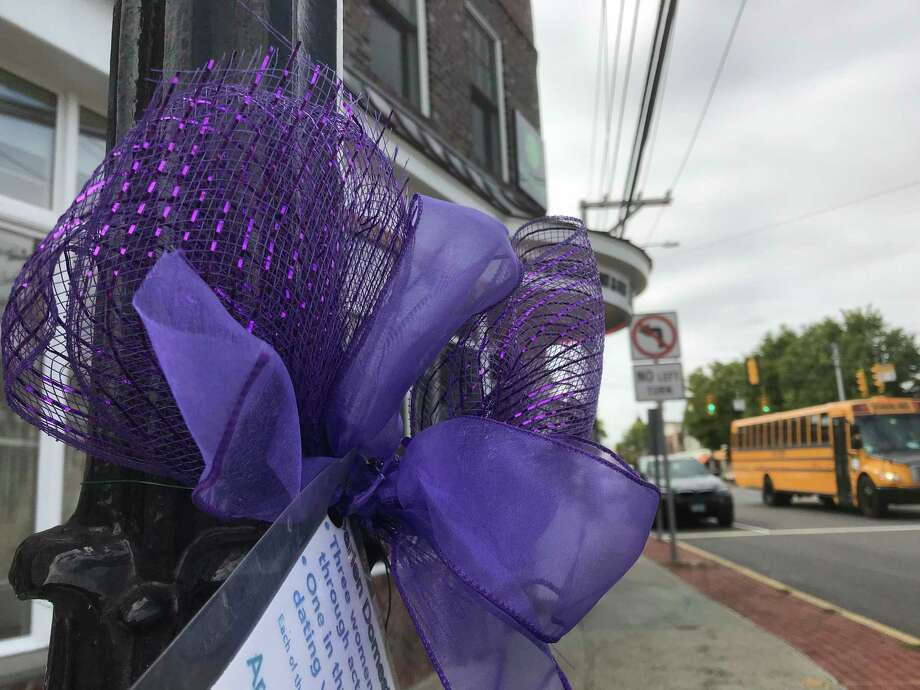 The Darien Domestic Abuse Council hung 40 purple ribbons around town this week. October is Domestic Violence Awareness month. Photo: Susan Shultz /Hearst Connecticut Media