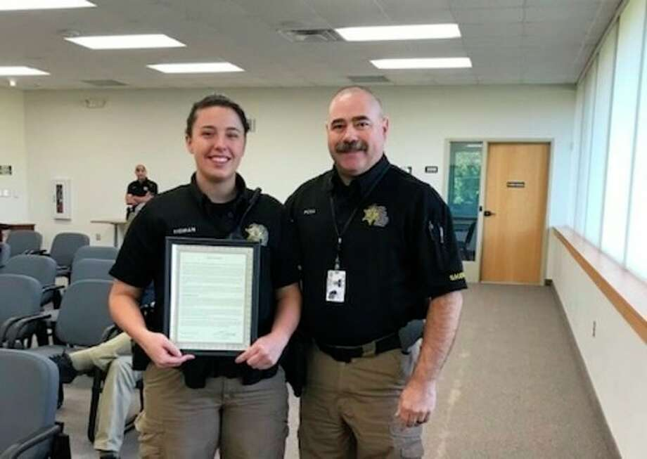 "Deputy Stephanie Homan (right) was given a commendation by Benzie County Sheriff Ted Schendel for her work in investigating several break-ins, which led to the ""Barefoot Bandit"" turning himself in. Homan is pictured with Undersheriff Kyle Rosa. (Courtesy Photo)"