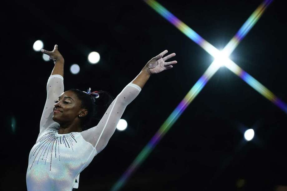 USA's Simone Biles reacts after performing on the vault during the womens all-around final at the FIG Artistic Gymnastics World Championships at the Hanns-Martin-Schleyer-Halle in Stuttgart, southern Germany, on October 10, 2019. (Photo by Lionel BONAVENTURE / AFP) Photo: LIONEL BONAVENTURE, AFP Via Getty Images / AFP or licensors