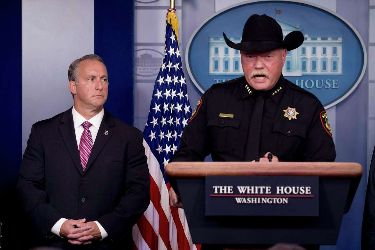 Tarrant County Sheriff Bill Waybourn, right, accompanied by Immigration and Customs Enforcement Director Matt Albence, speaks in the Briefing Room at the White House on Thursday, Oct. 10, 2019.