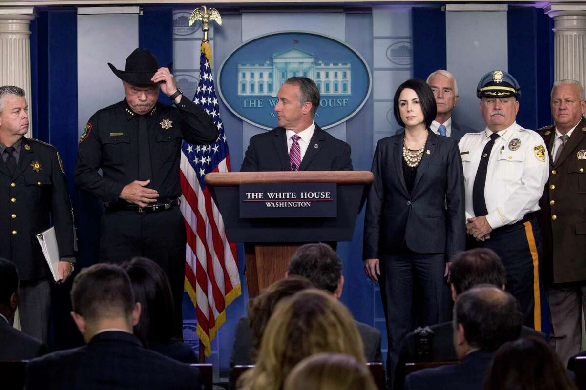 Immigration and Customs Enforcement Director Matt Albence, center, accompanied by sheriffs from around the country including Tarrant County, Texas Sheriff Bill Waybourn, second from left, speaks in the Briefing Room at the White House on Thursday, Oct. 10, 2019.