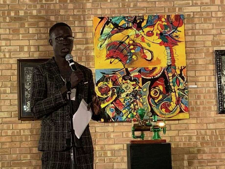 Rieek Nyoach, a 27-year-old Saginaw Valley State University student who was born in South Sudan, speaks during an event hosted by Nonviolent Peaceforce to raise awareness for peacekeeping efforts in the country at the Creative 360 building. (Mitchell Kukulka/Mitchell.Kukulka@mdn.net)
