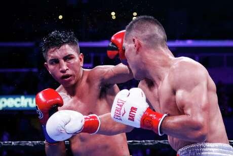 Mario Barrios fights against Batyr Akhmedov during the WBA World Super Lightweight Championship boxing match Saturday, Sept. 28, 2019, in Los Angeles. (AP Photo/Ringo H.W. Chiu)