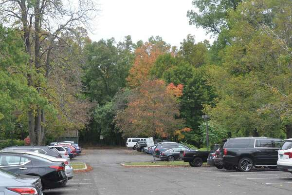 The planned new parking lot would be an extension at the far north end of the town's current Governor Street lot, and access would be through the current lot, from Governor Street.
