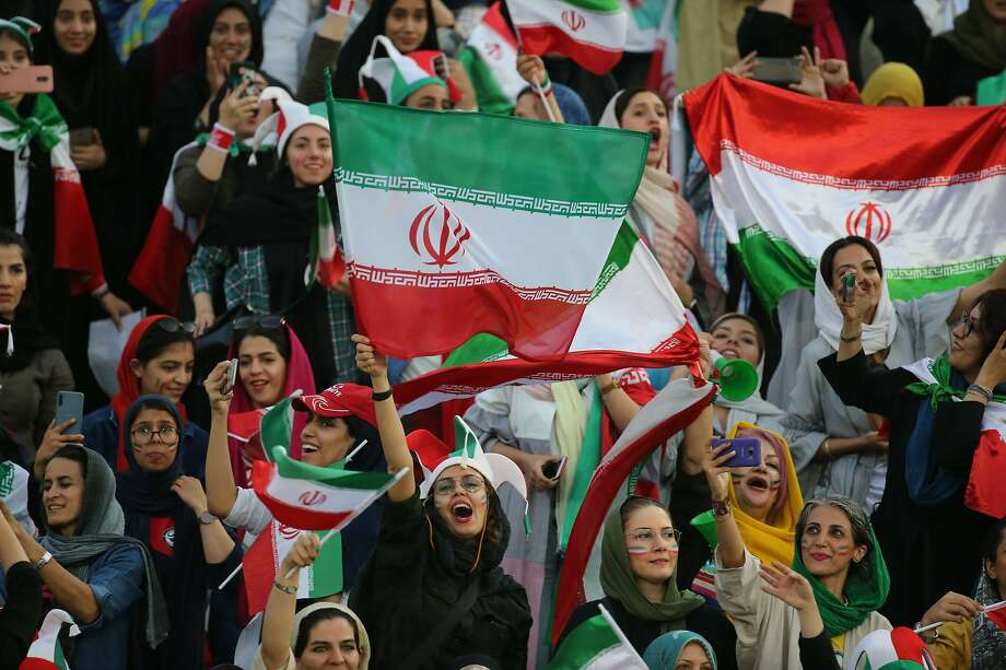 Iranian women cheer during a World Cup qualification match between Iran and Cambodia at the Azadi stadium in Tehran. Photo: ATTA KENARE / AFP Via Getty Images