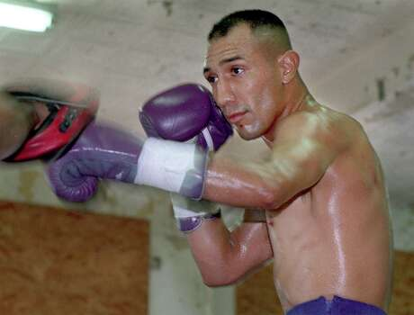 FOR SPORTS - Boxer John Michael Johnson who will fight for the world title in South Africa on May 29 worksout at Zarzamora Street Gym. PHOTO BY EDWARD A. ORNELAS 5-21-99