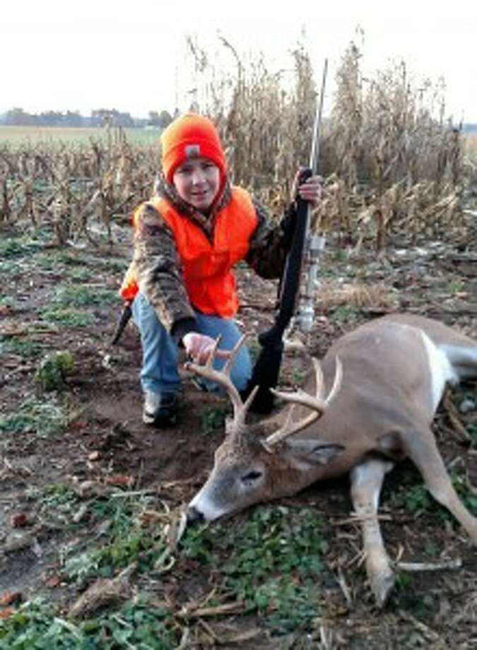 "REED CITY — Another deer season has ended, but successful hunters will have fond memories for quite some time. That includes Scott Harris, 41, of Reed City, who was a successful hunter way back on opening day, Nov. 15.Harris shot an 8-point buck with his .270 Ruger. He didn't realize ahead of time this particular buck was out there.""Me and some friends who had been watching the property knew there were some nice ones out there,"" he said. ""A friend of mine sitting on neighboring property to the east of me, I heard him shoot three times until I was paying attention in that direction. I saw some does walking across an edge of a hayfield behind a cornstrip and I was scoping that way. My son was watching with binoculars. He saw some does.""Then the buck appeared.""We were looking through some standing corn and couldn't tell,"" Harris said. ""He finally stepped out, looked at us and turned his head. We knew it was a decent one. I took the shot and he dropped in his tracks.""Harris said his shot was from about 250 yards. He hit the deer right behind the shoulder.""That's probably the best buck I've ever shot,"" he said. ""I think with the law changing here a little bit with the public shooting the larger deer, it's helping the quality of the deer if people are passing on the little spike and four-pointers. This deer wasn't overly huge, body wise, but he has a nice rack.""My buddy, he shot one with a bow that was a 10-point probably a mile and a half from there, but his body mass was just unbelievable. That 10-pointer we had never seen. But with the deer management and restrictions on the antlers, that's helping the quality of the deer."""