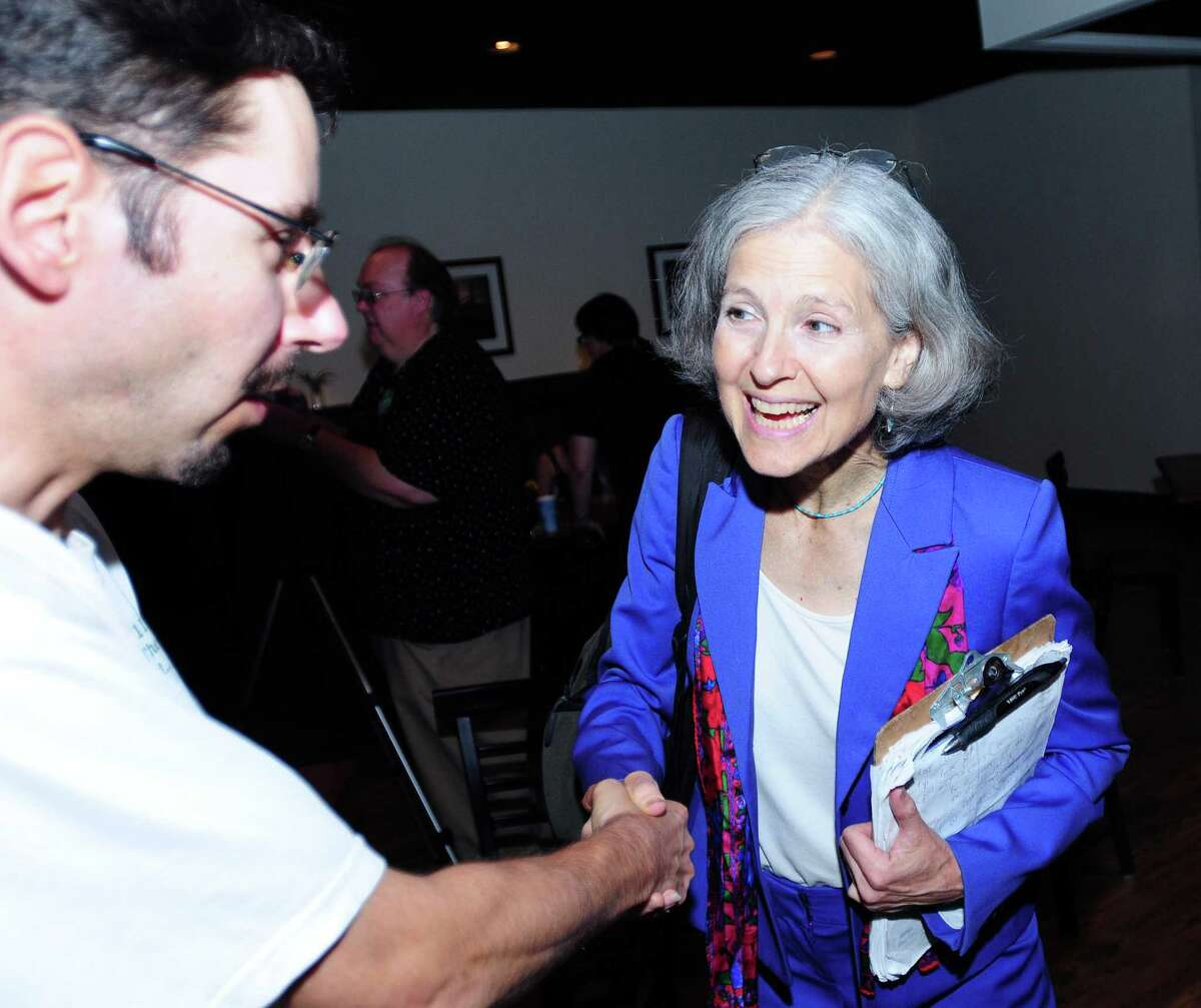 Rolf Maurer (left) of Stamford shakes hands with Green Party presidential candidate Jill Stein (right) at the Winchester Restaurant in Woodbridge on 6/29/2012. Photo by Arnold Gold/New Haven Register AG0454E