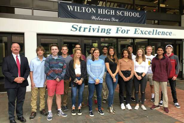 Wilton High School Principal Robert O'Donnell joins 15 of the school's 16 National Merit Commended Students. From left in front are Jackson Lent, Wictoria Matuk, Emma Babashak, Isabel Gouveia, Claudia Nanez, Katherine Buse and Dineth Karunamuni. In back are Justin Lipper, Zachary Muraskin, Devan Flores, Avi Sardana, Navod Jayawardhane, Nishant Wangneo, Alexander Schestag and Noah Sackowitz. Missing from photo is Larry Huang.