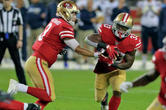 C. J. Beathard (3) hands off to Austin Walter (33) in the second quarter during a preseason NFL game between the San Francisco 49ers and the Los Angeles Chargers at Levi's Stadium in Santa Clara, Calif., on Thursday, August 29, 2019.