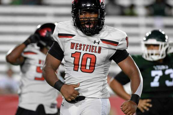 Westfield linebacker A.J. Holmes (10) celebrates his sack of Spring quarterback Aldyn Bradley during the first half of a high school football game, Friday, Sept. 27, 2019, in Houston.