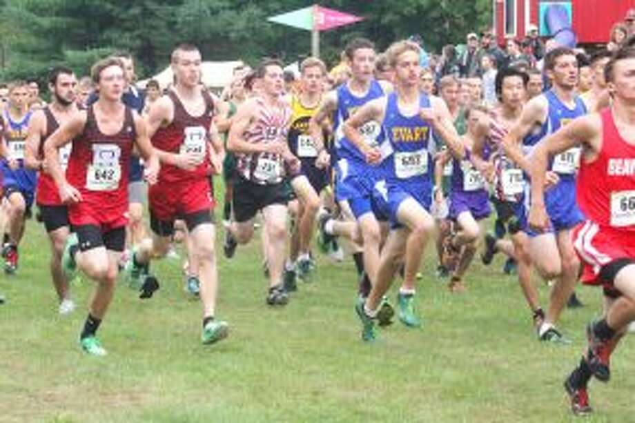 Invitational: Evart cross country runners get off to the start of the boys race at Saturday's home invitational. (Herald Review photo/John Raffel)