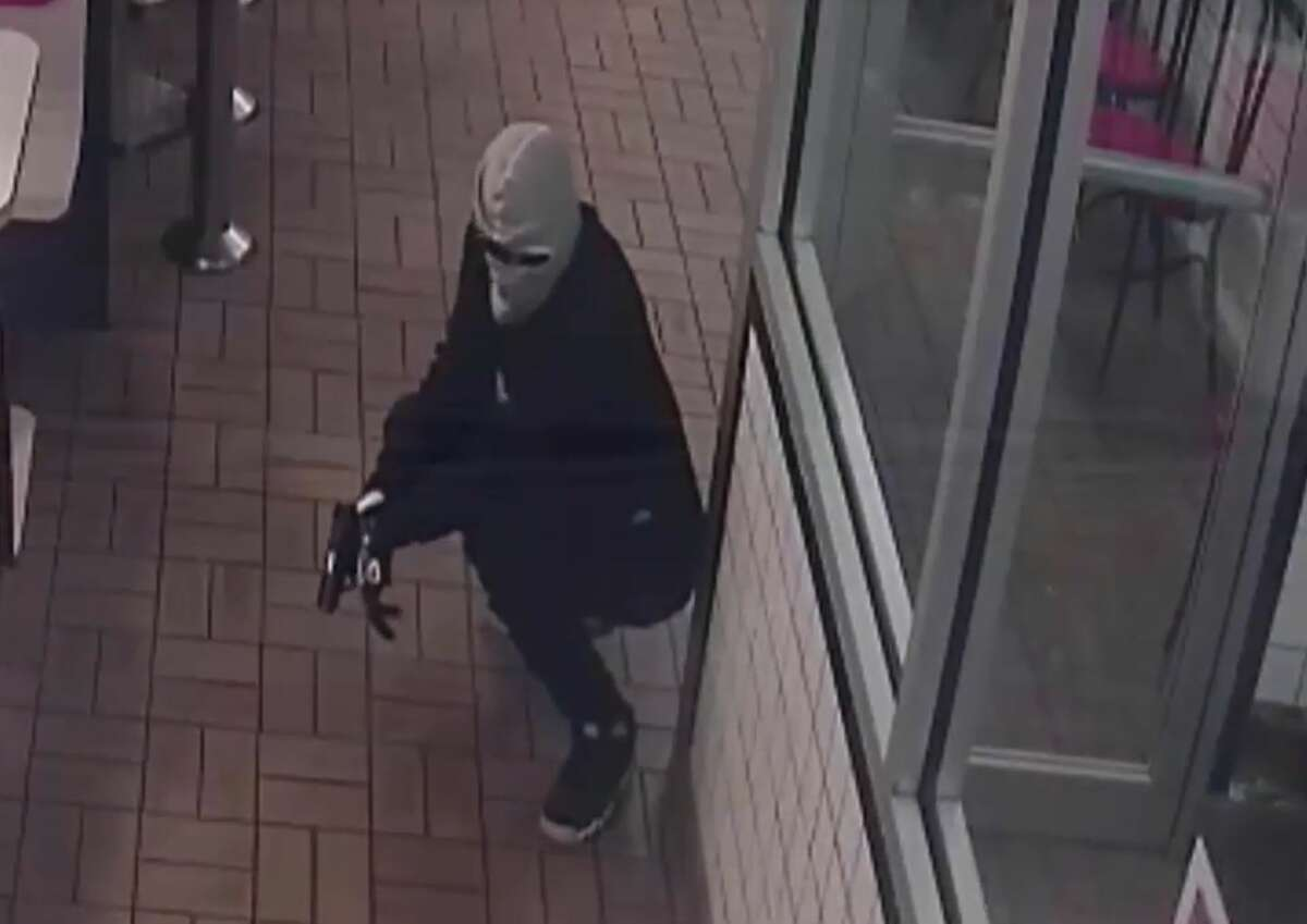 According to Houston police, three masked robbers enter the restaurant and immediately point guns at customers on the evening of July 23, 2019. The video shows customers inside forced to the ground, and one man is seen handing over his phone and wallet, along with other customers on the other side of the booths.