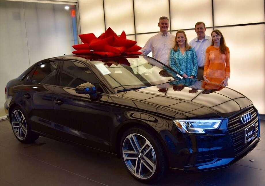 St. Laurence Catholic Church will host its 25th annual bazaar on Saturday, Oct. 19, from 5-10 p.m., and Sunday, Oct. 20, from 10 a.m.-5 p.m. Enter the raffle to win this 2019 Audi A3. Bazaar committee chairs, from left, are: Les Fuchs, Susan Yokley, Mike Turner and Colleen McKeever. For more information, visit stlaurence.org or call 281-980-9812. Photo: St.Laurence Catholic Church / St. Laurence Catholic Church