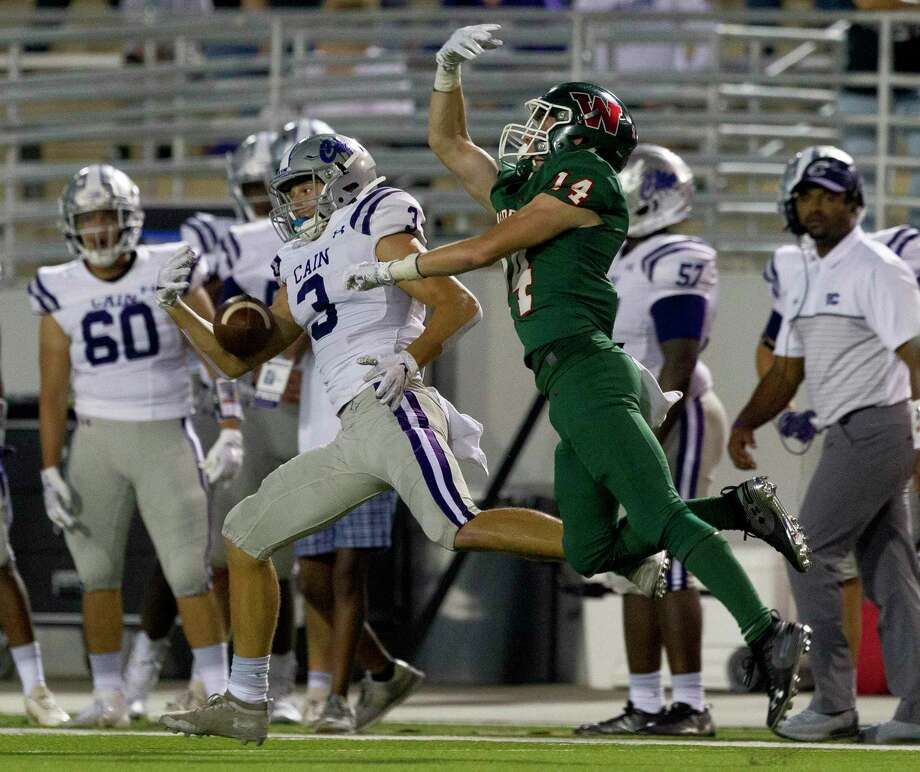 Klein Cain wide receiver Cole Monago (3) makes a one-handed catch as The Woodlands defensive back Carter Doucet (14) for a 83-yard touchdown during the first quarter of a District 15-6A high school football game at Woodforest Bank Stadium, Friday, Oct. 4, 2019, in Shenandoah. Photo: Jason Fochtman, Houston Chronicle / Staff Photographer / Houston Chronicle