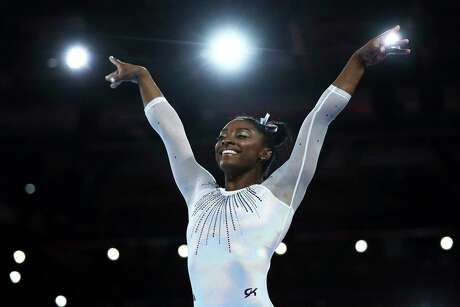 Simone Biles of the United States continues to make winning look easy, capturing the all-around title — the fifth of her career — at the world gymnastics championships in Stuttgart, Germany.