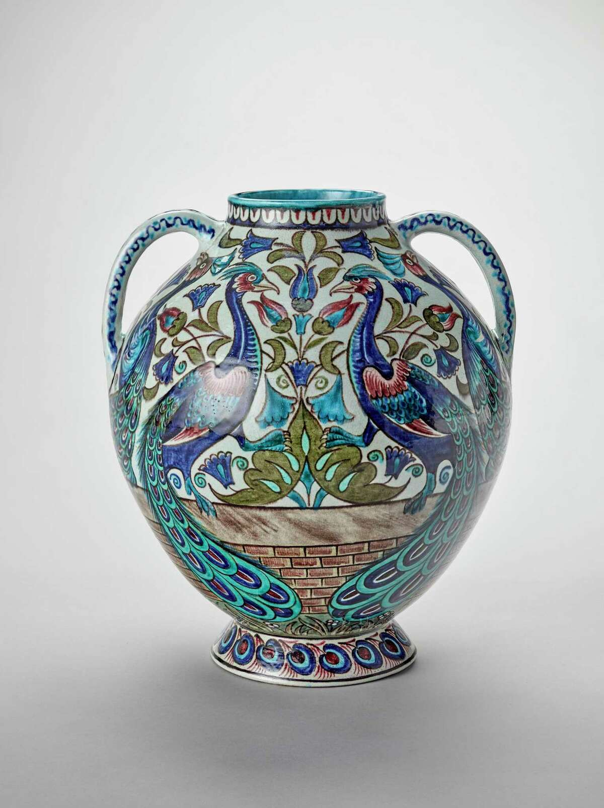 """An earthenware peacock vase, circa 1885, is part of the San Antonio Museum of Art as part of the exhibit """"Victorian Radicals: From the Pre-Raphaelites to the Arts and Crafts Movement."""""""
