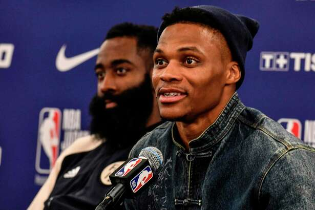 Houston's guard Russel Westbrook (R) answers questions beside James Harden (L) during a press conference after the NBA Japan Games 2019 pre-season basketball match between Houston Rockets and Toronto Raptors in Saitama, northern suburb of Tokyo on October 10, 2019. (Photo by TOSHIFUMI KITAMURA / AFP)