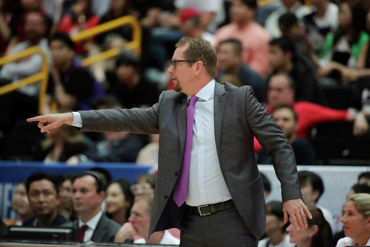 Toronto Raptors head coach Nick Nurse directs his team during the first half of an NBA preseason basketball game against the Houston Rockets Thursday, Oct. 10, 2019, in Saitama, near Tokyo. (AP Photo/Jae C. Hong)