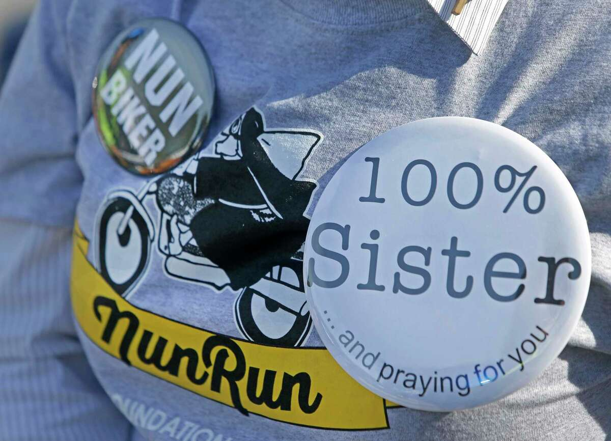 Sister Anita Brenek displays buttons saying nun biker and 100 percent sister on her t-shirt during of the 11th Annual Nun Run at St. Austin Center, 2002 S. Wayside Drive, Saturday, Oct. 17, 2015, in Houston. The 40 mile ride to San Leon benefits the CHRISTUS Foundation for HealthCare school-based clinics, which provide healthcare to children on campus in 17 low-income neighborhood schools. ( Melissa Phillip / Houston Chronicle )