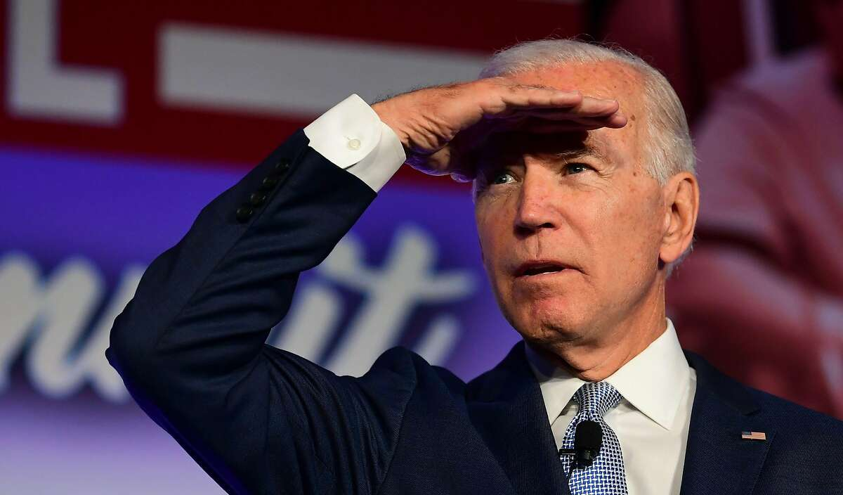 (FILES) In this file photo taken on October 04, 2019 Democratic Presidential hopeful Joe Biden looks on during the SEIU Unions for All Summit in Los Angeles, California. - Joe Biden's campaign lashed out October 9, 2019 at Facebook for refusing to block an ad from President Donald Trump which the Democratic candidate said included