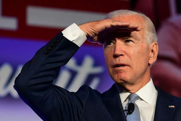 """(FILES) In this file photo taken on October 04, 2019 Democratic Presidential hopeful Joe Biden looks on during the SEIU Unions for All Summit in Los Angeles, California. - Joe Biden's campaign lashed out October 9, 2019 at Facebook for refusing to block an ad from President Donald Trump which the Democratic candidate said included """"definitively debunked conspiracy theories"""" on Biden. The Biden campaign responded after an exchange with Facebook over a Trump ad which accused Biden of improper dealings with Ukraine while he was vice president. (Photo by Frederic J. BROWN / AFP) (Photo by FREDERIC J. BROWN/AFP via Getty Images)"""
