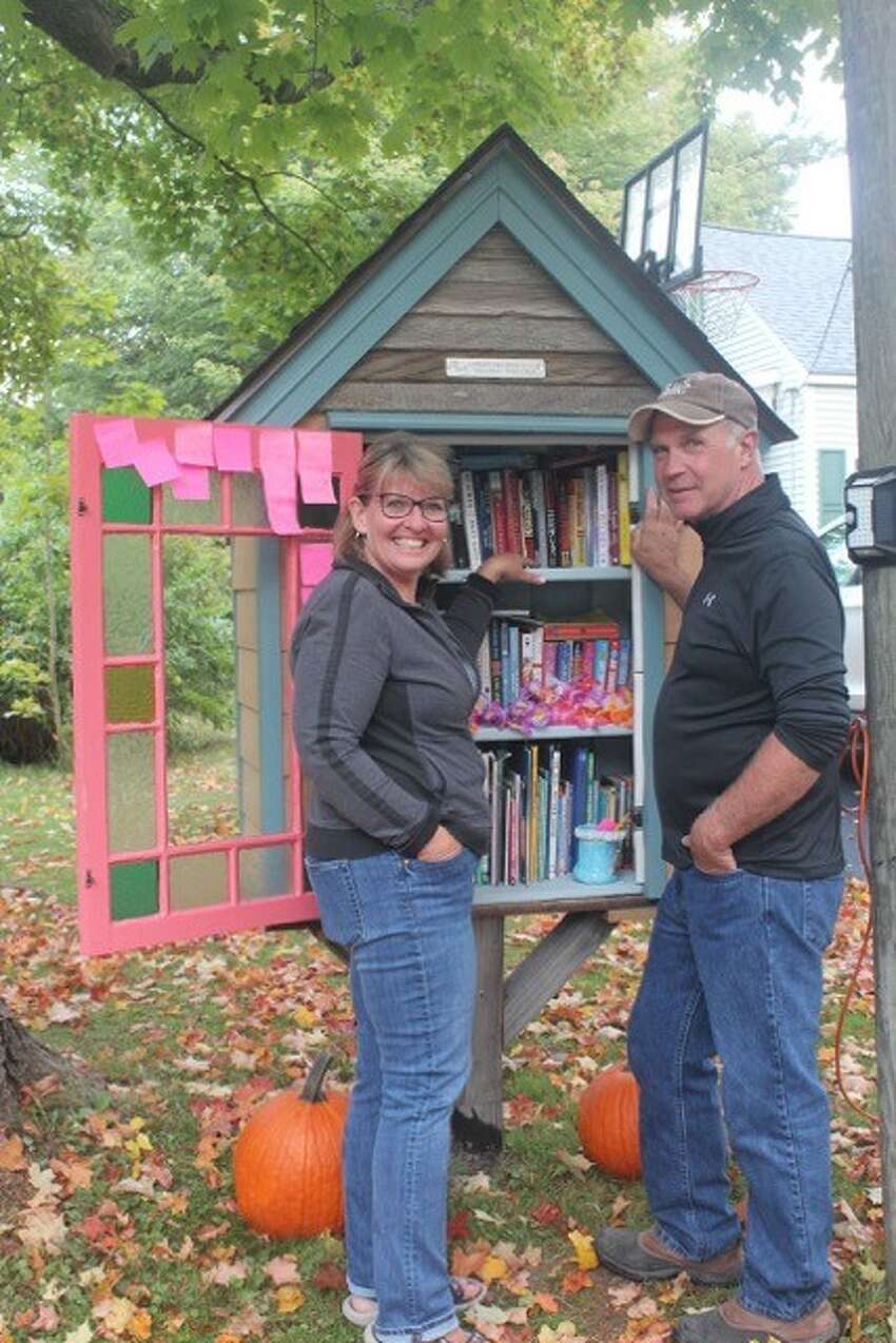 Patti and George Breen, next to their Little Free Library in Averill Park. (Photo by Donna Liquori)