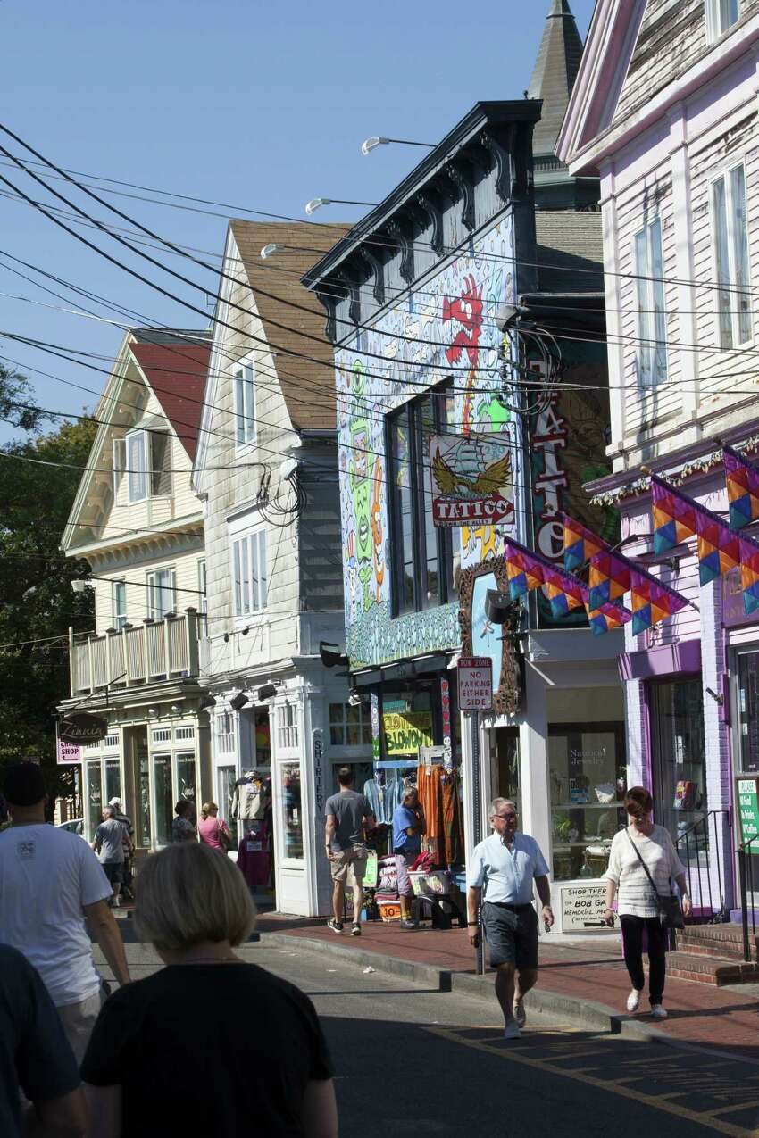 Tourists walk down the main street past shops and restaurants, September 17, 2015 in Provincetown, Massachusetts. (Photo by Melanie Stetson Freeman/The Christian Science Monitor via Getty Images)