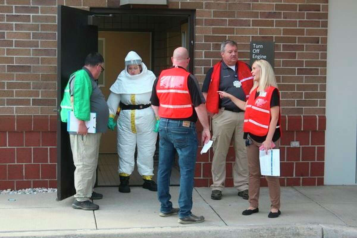The mass casualty incident drill at Spectrum Health Big Rapids Hospital featured two main scenarios, a hazardous spill at a nearby manufacturing facility and a multi-vehicle car crash on a freeway.In addition to examining fake wounds, the hospital emergency response team (HERT) was on-site, ensuring patients affected by the hazardous materials were being decontaminated as part of the exercise.(Pioneer photo/Taylor Fussman)