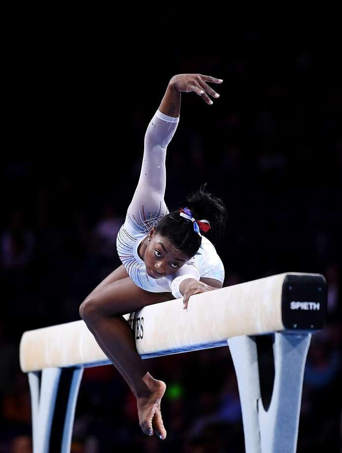 Simone Biles competes on the balance beam on her way to gold. Photo: Laurence Griffiths / Getty Images