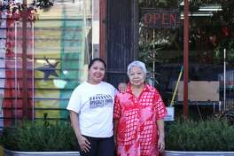 Specialty Foods Inc., an African Caribbean market in Oakland, will close after serving the area for 42 years. They started as a Filipino market in the 1970s before switching their focus to West African and Caribbean goods by the 1980s. In this undated photo, owner Nina Cruz is pictured with her mother.