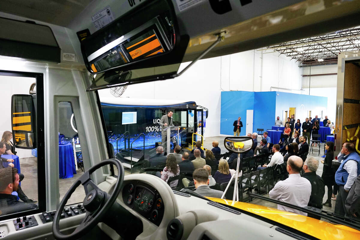 Looking out from an electric school bus, Peter Rego, chief commercial officer for The Lion Electric Co., speaks at a ribbon cutting event for the company's new electric vehicle showroom on Thursday, Oct. 10, 2019, in Green Island, N.Y. (Paul Buckowski/Times Union)