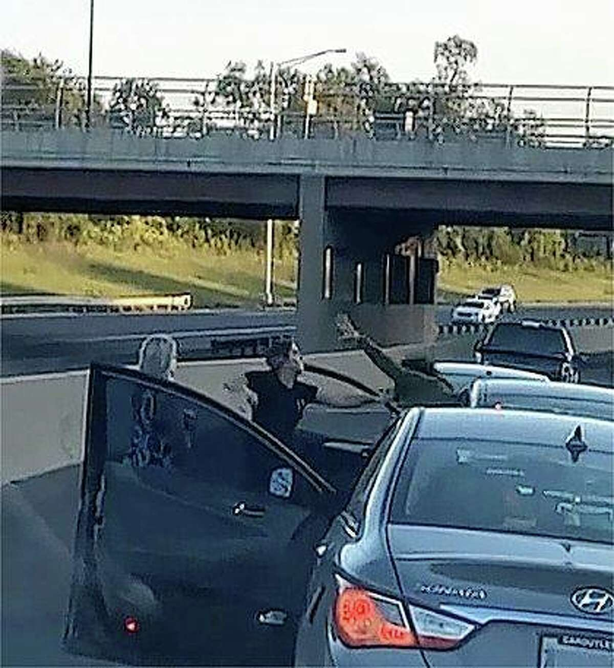A screen capture from a YouTube video shows an altercation that is believed to the result of road rage.