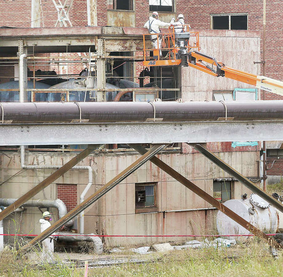 Workers wearing respirators disassemble a part of the former Wood River Power Station in East Alton Thursday. The site is under demolition and remediation. Photo: John Badman | The Telegraph