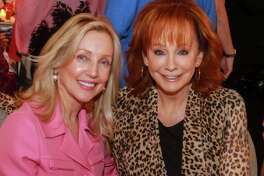 EMBARGOED FOR REPORTER UNTIL OCTOBER 11 Jona Lindig, left, and Reba McEntire at the 10th annual Razzle Dazzle luncheon at the Post Oak Hotel at Uptown on October 10, 2019.