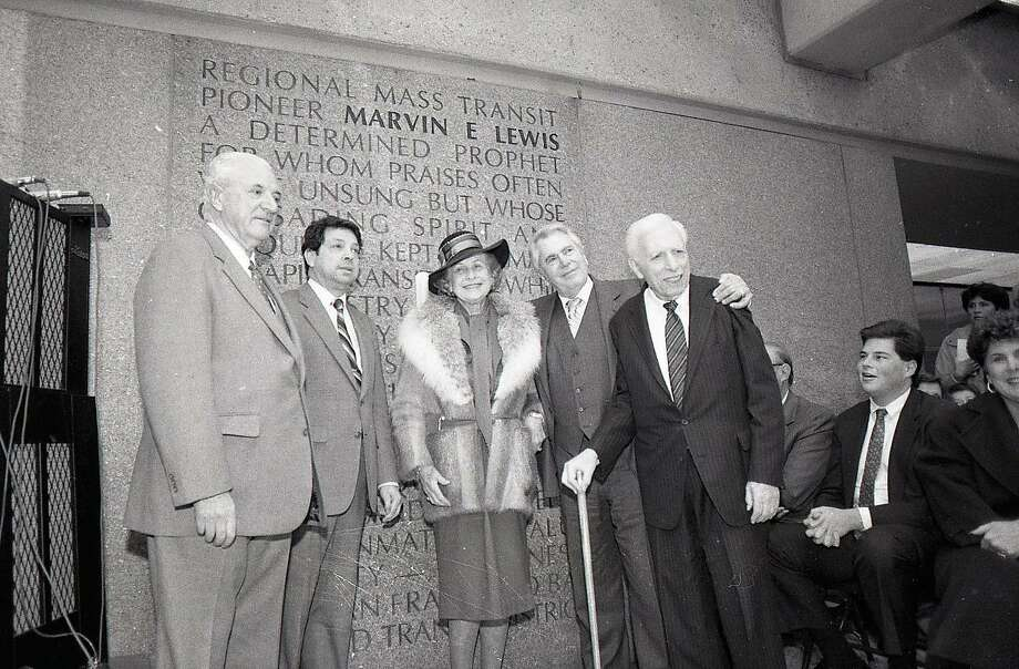 Feb. 6, 1986: Former San Francisco supervisor Marvin Lewis, standing second from right, is honored for his pioneering work for the Bay Area Rapid Transit system. His grandson Marc Benioff, seated at right, looks on. Photo: Mike Maloney / The Chronicle 1986